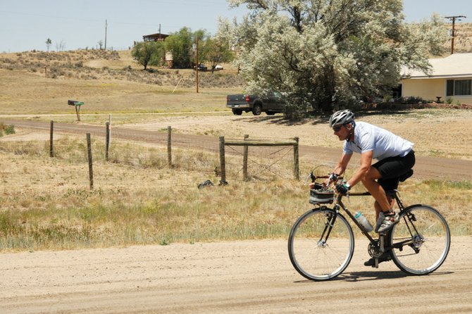 A cyclist bikes down Colorado Highway 13 on his way to Craig during the fourth leg of the Bicycle Tour of Colorado. More than 1,200 cyclists rode for 111 miles Tuesday from Saratoga, Wyo., to Craig. The Tour is in its 18th year and stopped in Craig for the first time.