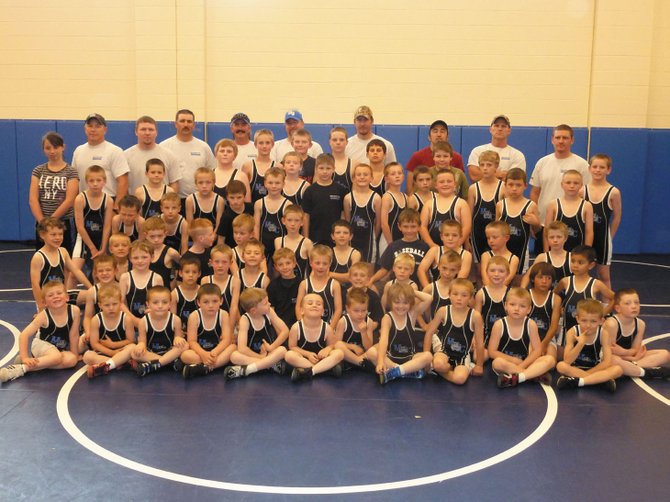 The Moffat County Youth Wrestling team and coaches pose for a picture. The team had its first season ever this spring and had 78 members sign up. Its coaches are made up of former Moffat County High School wrestlers. The team is pictured with the coaches, top row from left, Steve Durbin, Jeremiah Noland, Mark Voloshin, co-founder Chad Lawton, Chad Marshall, Neil Call, Anton Fredrickson, co-founder Mark Zimmerman and Phil Vallem. Coaches not pictured are Clint Haskins, Kurtis Kostur, Greg Hixson, Kip Hafey and Travis Linscum.