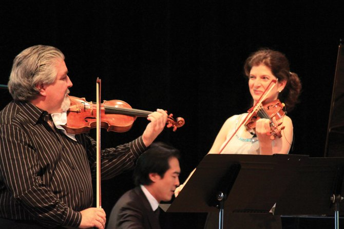 Andres Cardenes, left, and Monique Mead, right, are the music directors of Strings Music Festival. The festival opens its 25th season Saturday with the Opening Night Orchestra.