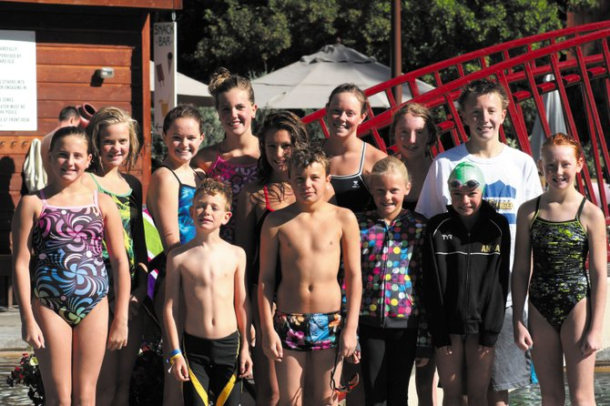Members of the Steamboat Swim Team celebrate after competing in Grand Junction during the weekend.