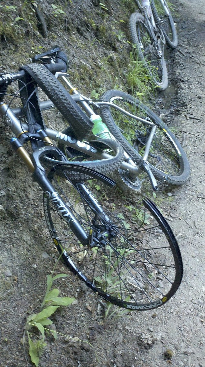 Local cycling advocate Corey Piscopo was uninjured, but his bike was severely damaged after a collision involving another cyclist Wednesday evening on Spring Creek Trail.