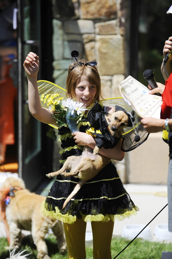 Delaney Ziegman reacts to winning the pet/owner look-alike contest during the Beast Walk event Saturday at Bud Werner Memorial Library.