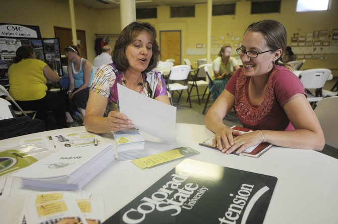 """Alicia Wille, right, a participant in the """"Gettin' Ahead in a Just Gettin' by World"""" class put on by Routt County social service agencies, visits with Routt County Extension Office Director Karen Massey on Monday at Holy Name Catholic Church."""