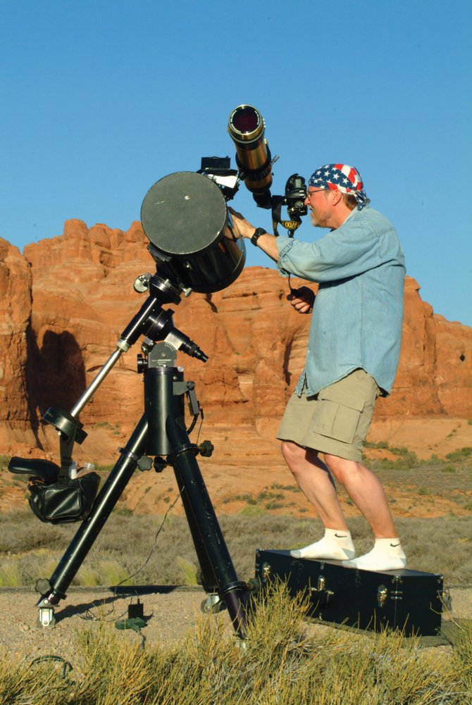 "Got telescope? Regardless, join Colorado Mountain College astronomy professor Jimmy Westlake (shown here in his stocking feet) and Stagecoach State Park naturalist Andrew Henry for the first annual ""Stagecoach Star Party"" at 9 p.m. Friday. View the moon and planets through the many different telescopes provided, or bring your own."