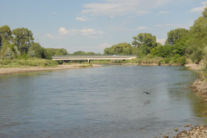 The Yampa River, pictured here from a Loudy Simpson Park access point, is flowing at a near-record-low rate according to data from Ron Dellacroce, Park Manager for River State Park and Elkhead Reservoir. The low water levels and high temperatures have prompted Steamboat Springs officials to enact a voluntary closing of the river, and access points in Yampa River State Park may not be far behind.