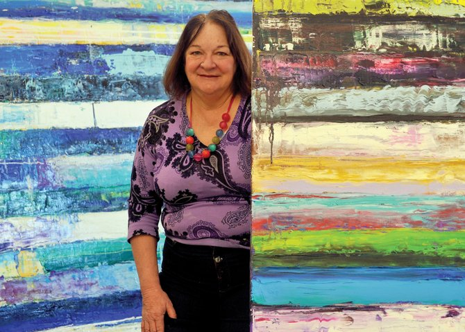From Trees to Stripes: Abstract artist Monroe Hodder at home in her Steamboat studio.