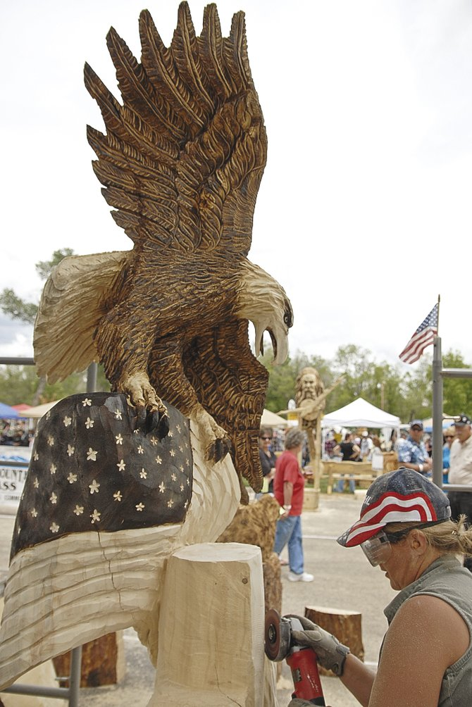 The Eagle Has Landed: A sculptor puts the finishing touches on an entry at Craig's Whittle the Wood Rendezvous.