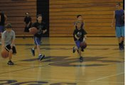 Campers at the Moffat County High School basketball camp work on dribbling and jump-stopping Tuesday during a drill at MCHS. The camp was Monday through today for boys from grades four through eight. Incoming MCHS sophomore Matt Hamilton (right) helps the players with the drill.