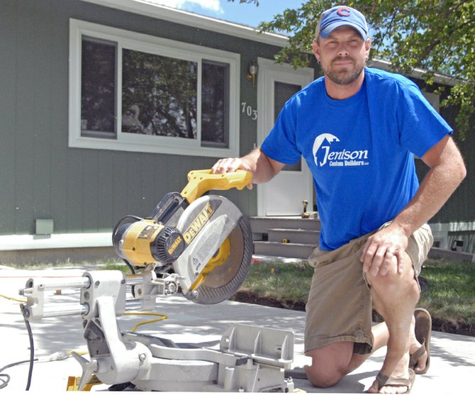 Justin Jenison, of Jenison Custom Builders, cuts wood for a patio project at Tim Kjera's home in Craig's Ridgeview subdivision. Kjera said Jenison was highly recommended by everyone he spoke to when he began shopping for a construction contractor. Craig Daily Press readers earmarked Jenison Custom Builders as best builder and construction company as part of the 2012 Best of Moffat County contest.
