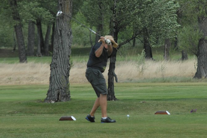 A golfer tees off the 10th hole Yampa Valley Golf Course Thursday. The course is hosting its largest tournament of the summer, the Cottonwood Classic this weekend. The tournament will play through Sunday evening, with food and entertainment over the weekend.