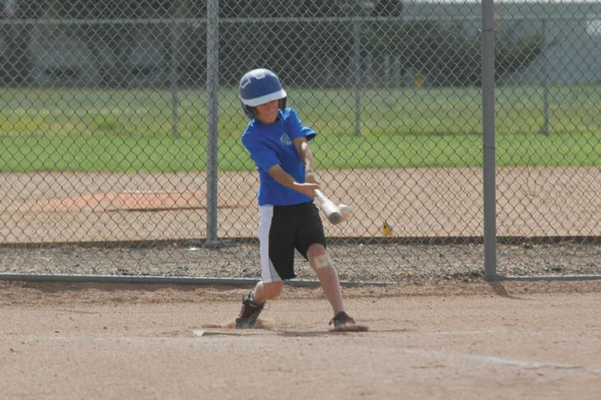 Tommy Baker, 12, connects with the ball Wednesday during practice. Baker is one of the team captains for the Moffat County Cutthroats, a Triple Crown baseball team from Craig. The Cutthroats' next tournament is the Colorado State Championships from July 13-15 in Aurora.