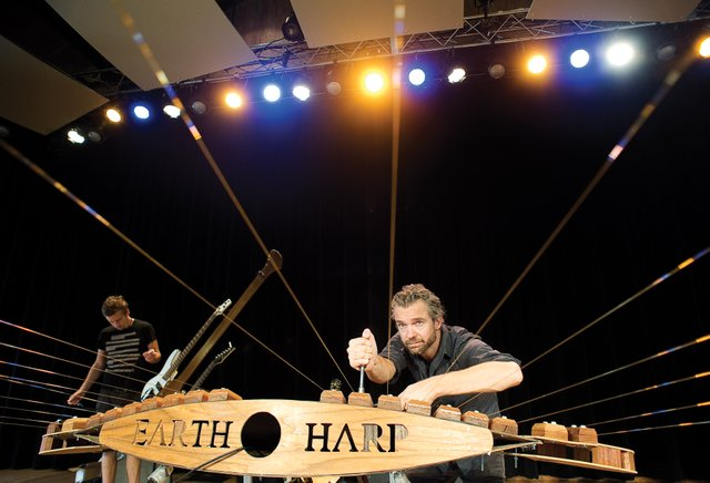 William Close, founder and artistic director of the MASS Ensemble, tunes the Earth Harp Friday afternoon at the Strings Music Pavilion. The group performs Saturday night and will appear at the Strings Free Community Day at 12:30 p.m. Sunday.
