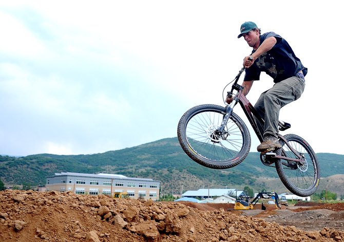 Geoff Hollister takes flight on his bike Friday as he showed off Bear River Bike Park, which is nearing completion on the west end of Steamboat Springs.