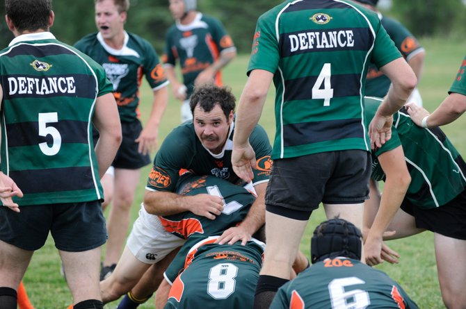 Steamboat Rugby Club captain Chris Baumann tries to clear a pile Saturday during a game with Glenwood Springs. Baumann was named the Man of the Match in helping Steamboat to an easy 61-0 win.