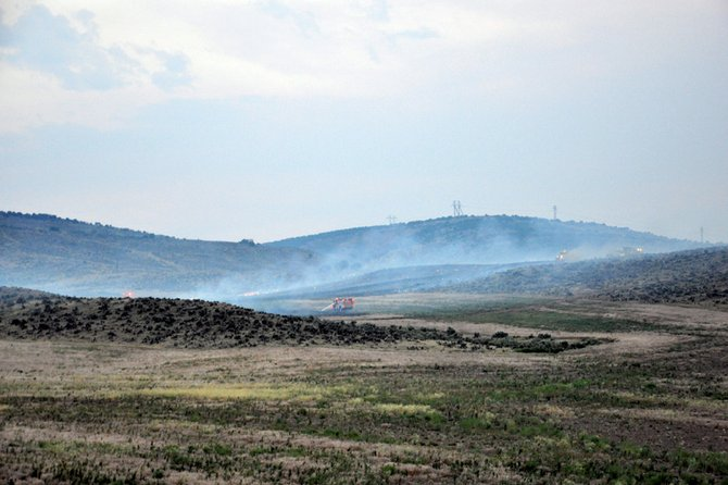 Firefighters battle a blaze Saturday night near Colowyo Coal Co. The fire was reported at about 7:45 p.m. and had scorched an estimated 80 acres by about 8:30 p.m.
