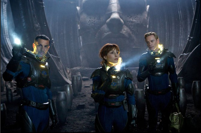 "From left, scientists Charlie Holloway and Elizabeth Shaw (Logan Marshall-Green, Noomi Rapace) and android David (Michael Fassbender) investigate the interior of a cave on a moon light-years away from Earth in ""Prometheus."" The movie is a prequel to the ""Alien"" series, concerning a team seeking an extraterrestrial race believed to have created humankind."