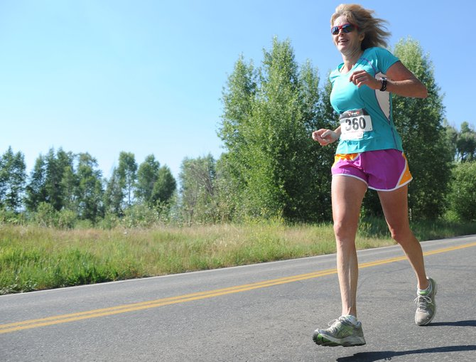 Angela Treiterer runs Sunday in the Mountain Madness half-marathon in Steamboat Springs. The race drew about 150 runners for a dash along the Yampa River.