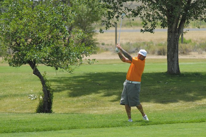 Keith Humerickhouse, of Eagle, watches his shot on the first hole at Yampa Valley Golf Course Sunday. Humerickhouse shot a 213 over 54 holes at the Cottonwood Classic over the weekend, and won the tournament for the second year in a row.