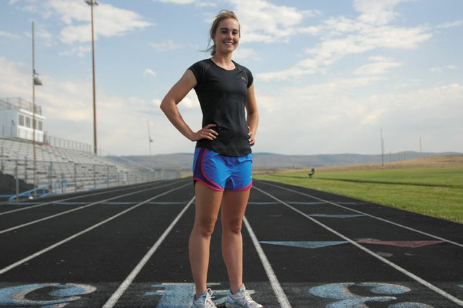 Maddy Jourgensen stands on the track at Moffat County High School, where she starred running the 3200-meter run. A 2011 MCHS graduate, Jourgensen will begin her sophomore year in the fall at Augustana College in Sioux Falls, S.D., where she runs track and cross-country.