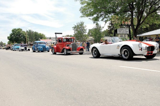 A string of classic cars drives down Victory Way during the 2011 Independence Day parade. This year's parade is scheduled to start at noon Wednesday at Veterans of Foreign Wars Post 4265, 419 E. Victory Way, and will continue down Victory Way to Craig Post Office, 556 Pershing St.