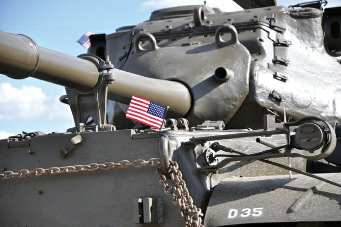 An American flag flutters on an M47 tank shortly after its arrival June 27 at Wyman Living History Museum. Lou Wyman, the museum's founder, purchased the newly restored tank five years ago and plans to display it during today's Fourth of July parade, scheduled to start at noon at Veterans of Foreign Wars Post 4265, 419 E. Victory Way.