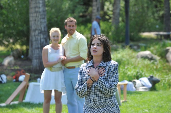 "Actor Jacquie Fee performs during a rehearsal for ""Tartuffe"" Tuesday at Yampa River Botanic Park. Tartuffe is part of the Piknik Theatre Festival, which kicks off at the park Friday with ""Twelfth Night."""