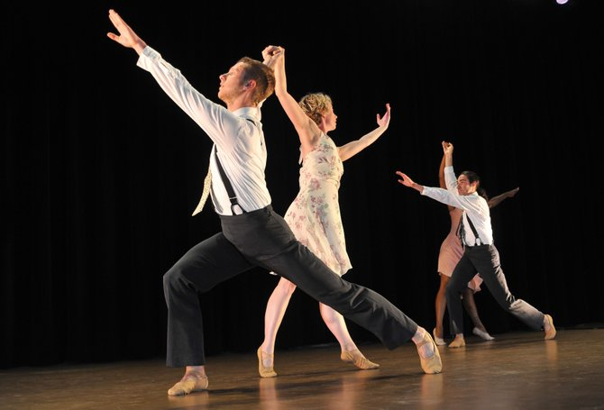 "Dancers Nicholas Ranauro, front, and Jennifer Golonka rehearse a dance piece Friday at the Strings Music Pavilion. The Perry-Mansfield Performing Arts School and Camp dancers combined their talents with Strings Music Festival musicians for Saturday's ""Dance & Camaraderie."" The show is scheduled for 8 p.m."