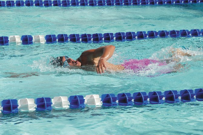 Matt Hulstine, 18, swims the 1,500-meter freestyle Friday at the Craig ABC swim meet. It was Hulstine's first 1,500 in two years, and he finished in 18:37.18. The swim meet continues at the Craig Swimming Complex today and Sunday.
