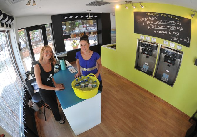 Fro-yo employee Ashley Vaughn, left, and owner Katy Vaughn stand inside the new frozen yogurt store in downtown Steamboat Springs.