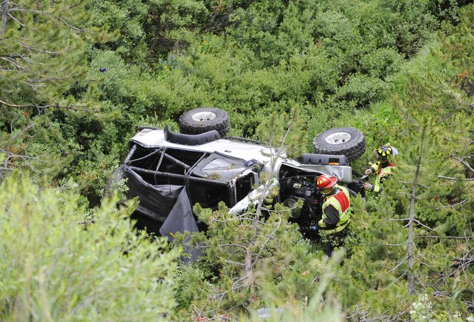 Steamboat Springs Fire Rescue firefighters work at the scene of a fatal car crash Saturday afternoon on Rabbit Ears Pass.