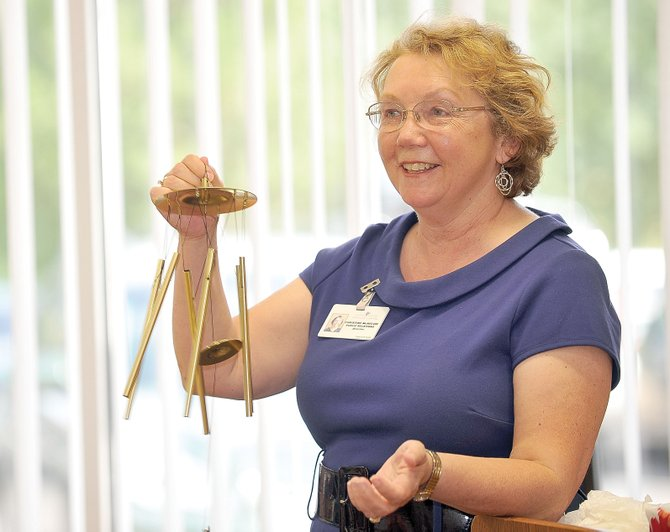 Christine McKelvie holds up a wind chime, a parting gift after 30 years with Routt Memorial Hospital and Yampa Valley Medical Center. The gift reflected McKelvie's trademark chime at the beginning of public announcements at the hospital.