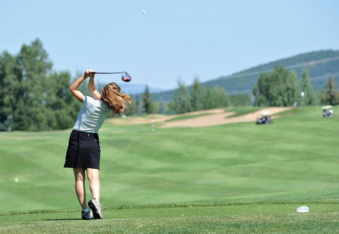 Krista Moser tees off during the 13th annual Rally for the Cure golf tournament at the Rollingstone Ranch Golf Club. The tournament drew 232 golfers.