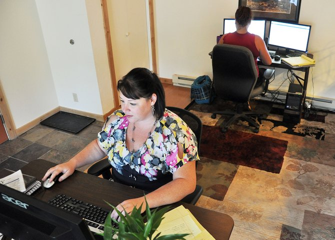 LDM Global marketing and customer service manager Sarah Nunham, front, and accountant Amy Maxwell work out of a condo Wednesday near Mount Werner. LDM Global CEO Chris O'Reilly said he plans to expand his location-neutral business by doubling the staff and establishing a permanent headquarters in Steamboat.