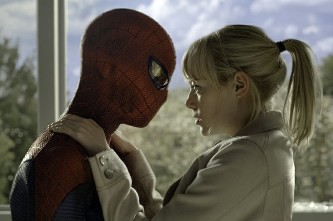 "Superhero Spider-Man (Andrew Garfield) grabs hold of love interest Gwen Stacy (Emma Stone) in a moment of danger in ""The Amazing Spider-Man."" The movie is a retelling of the origins of Marvel Comics character with new elements."