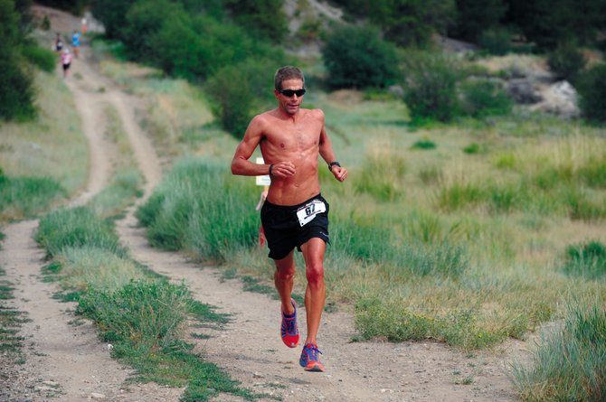 Boulder triathlete Michael Lovato finishes the Howelsen 8-miler on Saturday. Lovato, who is training for his 30th Ironman, was the top men's finisher.