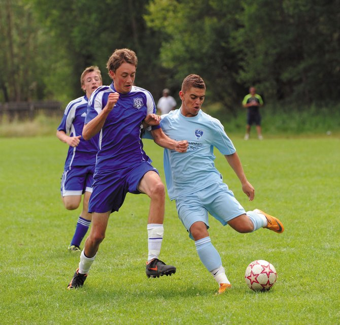 Steamboat Springs U18 soccer player Alan Flores kicks the ball Saturday at Emerald Field. Flores, who plays for Moffat County, was playing with Steamboat in the Steamboat Mountain Soccer Tournament.