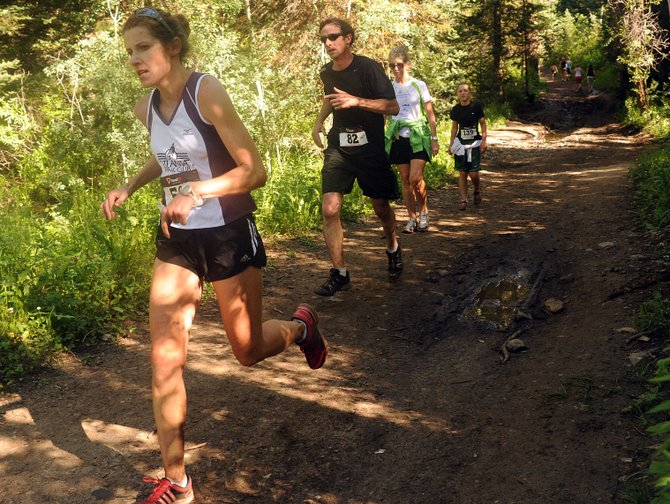 Beth Olds leads the way down the Spring Creek Trail during last year's Spring Creek Memorial run in Steamboat Springs. This year's event returns Saturday with 9-mile and 5-kilometer races.