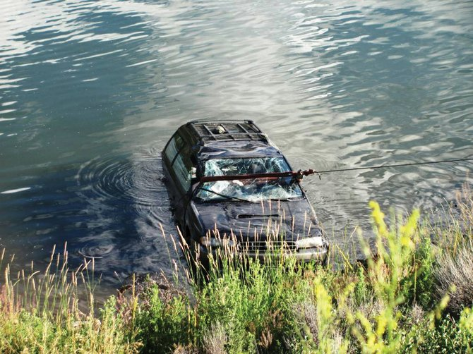 A Subaru Outback is pulled out of Stagecoach Reservoir on Wednesday afternoon after it rolled down an embankment from Routt County Road 18. Neither the driver nor the passenger were seriously hurt.
