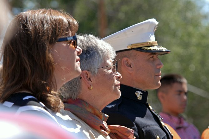 Jeanne Wayne, left, Sandra Adams, center, and U.S. Marine Corps Col. John Adams, right, participated Friday in a ceremony dedicating the Craig Veterans Telehealth Clinic to their late father and husband's memory. U.S. Army Maj. William E. Adams, of Craig, was killed in action in 1971 while attempting to fly a helicopter rescue mission during the Vietnam War. He was posthumously recognized with the Medal of Honor for his heroism.