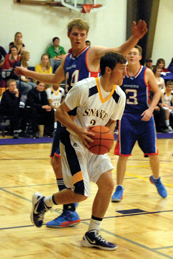 Former Little Snake River Valley High School player Rex Stanley looks to pass during an LSRV game in January. Stanley and two other Rattlers, Daniel Wille and Miles Englehart, played in the Wyoming Coaches Association Boys Basketball All-Star game Saturday.