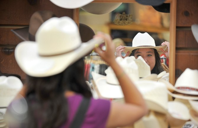 Michelle Shen, from New Jersey, shops for cowboy hats at F.M. Light & Sons in downtown Steamboat Springs on Tuesday afternoon. City officials are working to change the way community groups like Mainstreet Steamboat Springs apply for city funding.