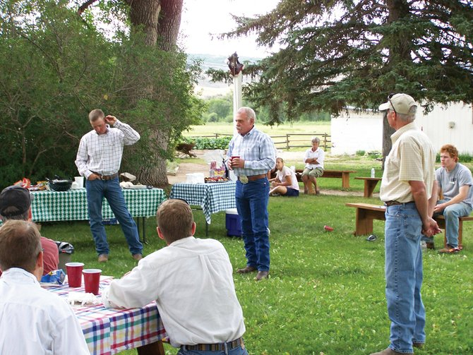 Terry Jost, center, Yampa Valley rancher and president of Mountain Valley Bank, talks Tuesday at Carpenter Ranch near Hayden about the affects this summer's drought have had on both his personal ranching operation as well as on the financial side of the industry. Standing with him are Lee Curby, left, who leases land with Jost on Carpenter Ranch, and Geoff Blakeslee, manager of Carpenter Ranch.