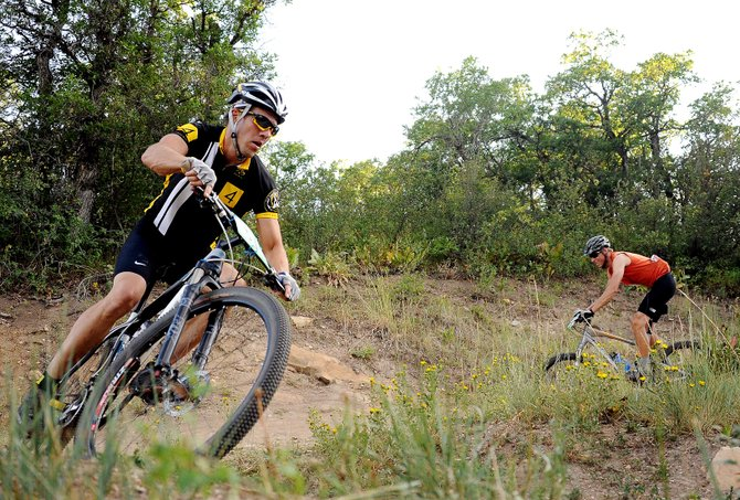 Jeff Minotto rides Wednesday in the Town Challenge Mountain Bike Series race in Steamboat Springs. Minotto serves on the Ride 4 Yellow board, and on Wednesday, he broke out the event's jersey. Board members said they're hoping to raise more than $100,000 at this year's third annual event.