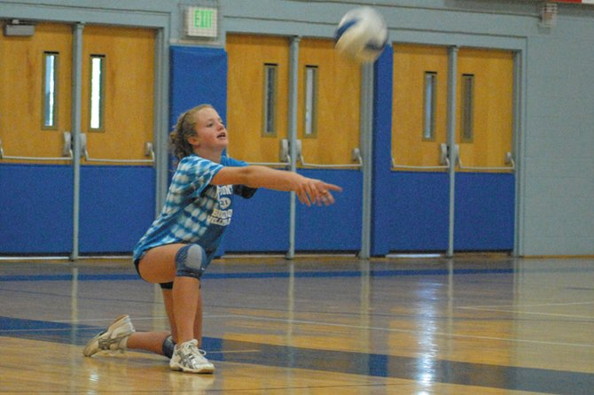 Incoming eighth-grader Emma Samuelson bumps the ball Tuesday at MCHS gym during a volleyball camp for middle school players. The camp continues today from 5:30 to 7:30 p.m. and concludes Thursday.
