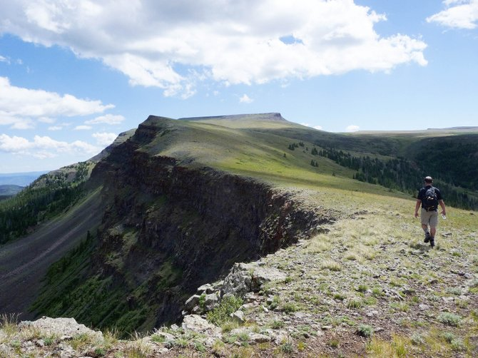 Steamboat Springs resident Marty Gilligan hikes along a cliff in the Flat Tops Wilderness Area toward the top of Flat Top Mountain. At 12,354 feet, its the highest peak in Northwest Colorado.