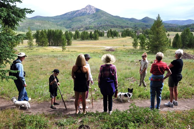 DeAnna Thoma leads an interpretive nature hike Sunday morning at Steamboat Lake State Park. Routt County's state parks are reporting strong visitor numbers despite stringent fire restrictions.