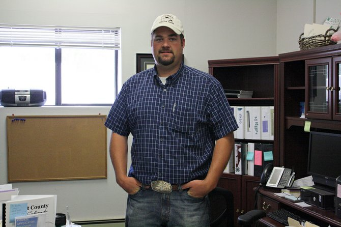 J.D. Sexton, pictured here at the Moffat County Extension Office, 536 Barclay St., began work June 18 as the Moffat County Extension and 4-H youth agent. He said his duties include coordinating local 4-H programs and supporting the local ranching and agriculture community.