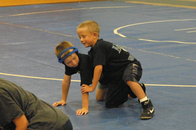 Youth wrestlers attended a camp organized by the Moffat County Youth Wrestling Team and led by former All-American wrestler Tanner Linsacum. Linsacum said he tried to teach the basics, and give campers experience with various wrestling positions.