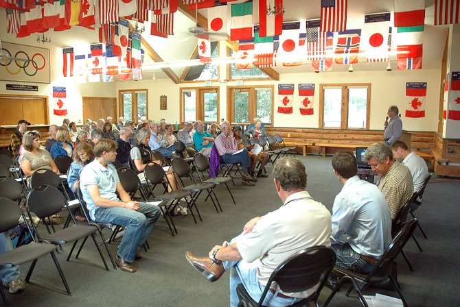 Community members listen Monday night to members of the Sleeping Giant Group during a meeting at Olympian Hall about the proposed casino near Yampa Valley Regional Airport in Hayden.