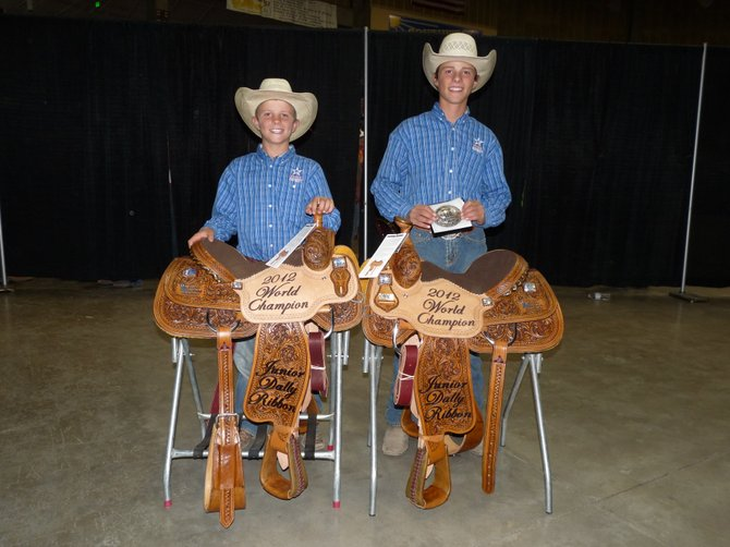 From left, South Routt County's Jace Logan, 11, and Eric Logan, 14, pose for a photo after winning a world championship in ribbon roping at the Little Britches National Finals Rodeo in Pueblo.